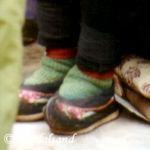 China - Kunming - Old lady with small feet. The ancient custom of tying the feet of young girls was prohibited after the revolution. One can still see a few old women who have gone through this terrible ordeal