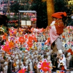 Japan - Bodhisattvas placed by worshippers in the garden of a Buddhist temple in Kamakura.