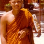 Thailand - Young monk at Wat Prathat Buddhist temple outside Chiang Mai