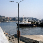 Turkey - Istanbul - The Galata Bridge with the Galata Tower to the left on the other side