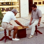 Turkey - Alanya - A game of backgammon while shopowners await customers