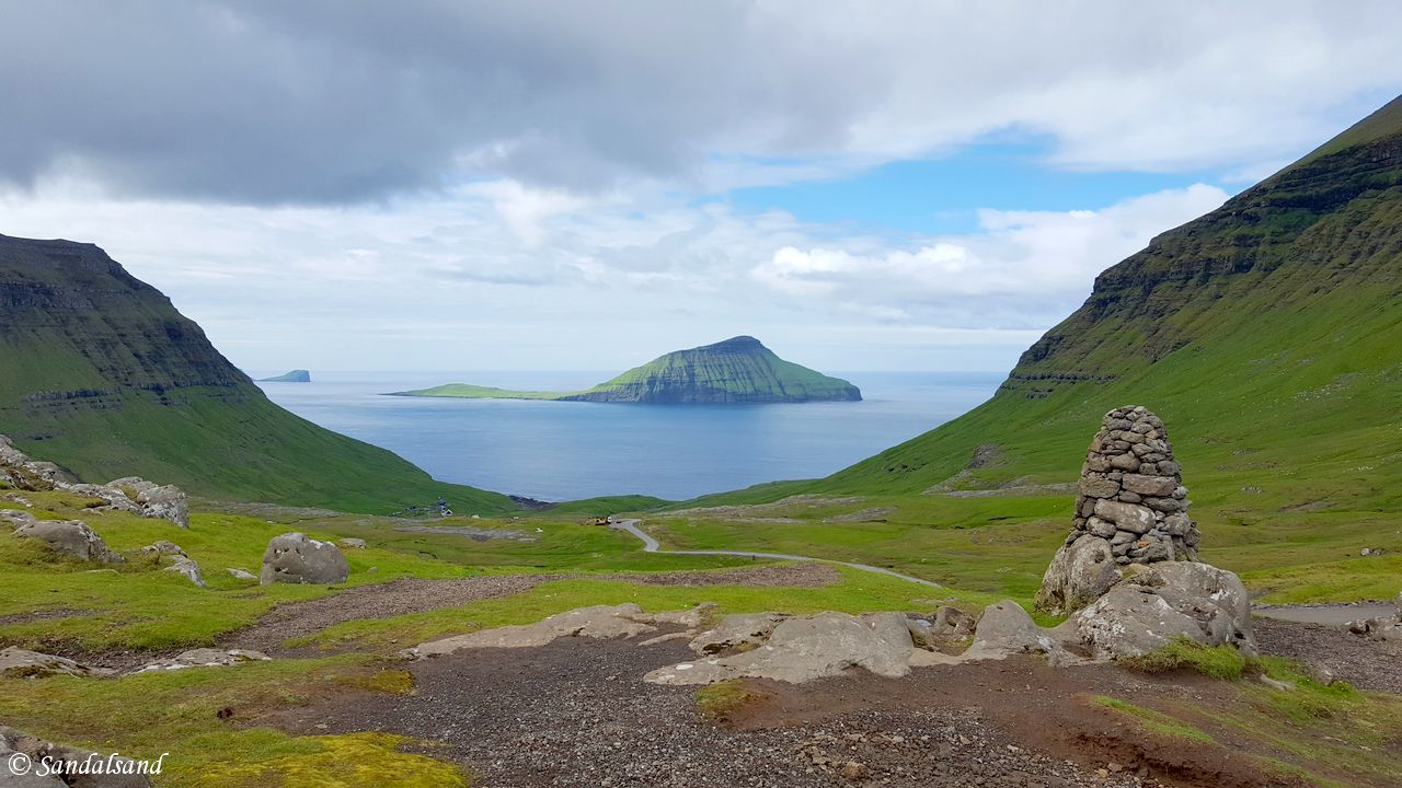 Panoramic view from Oyggjarvegur on Streymoy with the island of Koltur in the distance